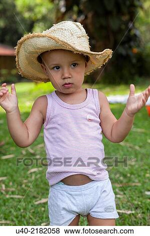 Pictures of 2 year old boy outdoors with cowboy hat. u40-2182058 ... 9b70ec3132b