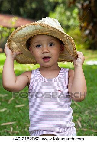 2 year old boy outdoors with cowboy hat. Stock Photo u40-2182062 7b2c76b9415