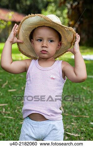 Stock Photography of 2 year old boy outdoors with cowboy hat. u40 ... f00b1b9dcdf