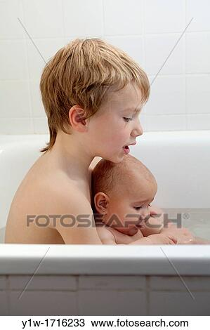 Stock Photo of 5 year old boy and his 6 months old sister in bathtub ...