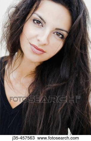 Stock Photo Of A Young Woman 20 S To 30 S With Long Dark Hair A Calm