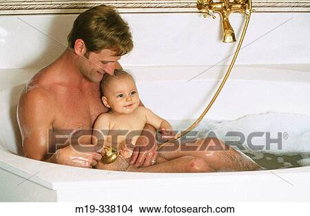 Stock Photo of dad with baby in bath tub m19-338104 - Search Stock ...