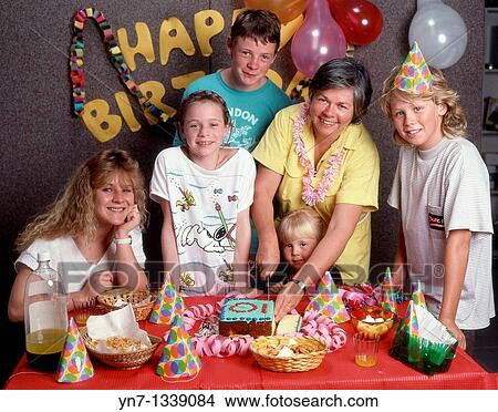 stock photo of happy family groups at ten year old s birthday party