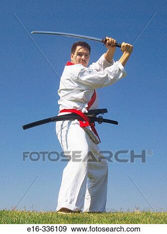 Karate man with sword Stock Photo