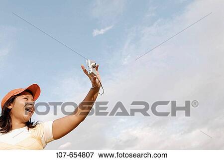 Debout, Tablette, Femme, Numérique, Devant, Portrait, Pilote Hélicoptère  Photo Libre De Droits