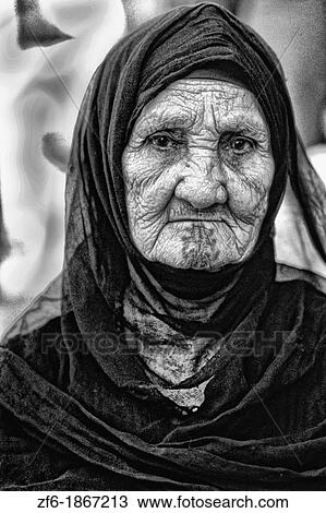 Old Muslim woman portrait in traditional clothes and tattoos in Cairo Egypt  Stock Image