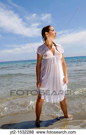 And Attractive Red Haired On The Beach Wearing A Wet White Dress Ibiza Spain