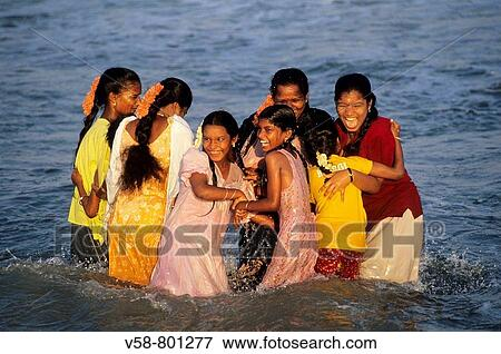 Picture of cheerful girls bathing marina beach chennai for Mural fish in tamil