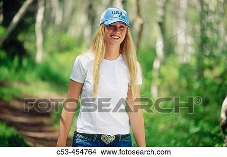 2079c3fc1d3e4 Stock Photo - Woman wearing beret in summer in forest. Fotosearch - Search  Stock Images