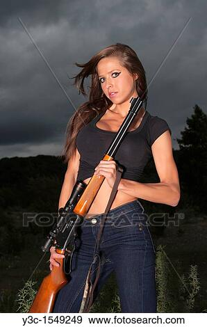 Stock Photograph Of Young Sexy Woman With Hunting Rifle Y3c 1549249