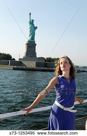 Young Woman On A Ferryboat Close To Liberty Statue
