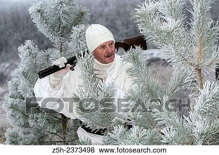 7fb88ebee156f Stock Photo - Winter hunting in white camouflage suit. Belgorod region..  Fotosearch
