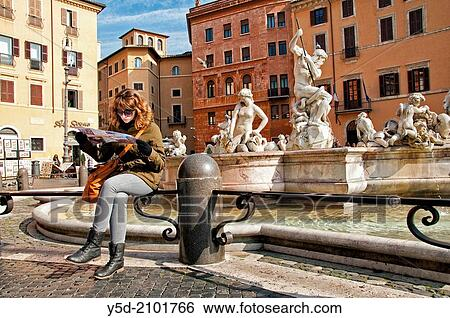 Stock images of young woman studying touristic map of rome piazza young woman studying touristic map of rome piazza navona historical centre listed as world heritage by unesco rome lazio italy europe gumiabroncs Images