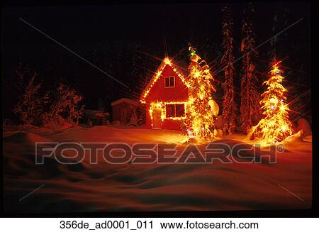 Dark Christmas.Girdwood Southcentral Alaska Christmas Lights Cabin Trees Winter Night Dark Colorful Snow Stock Image