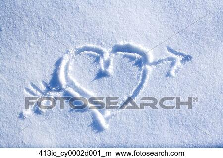 stock photo of drawing of heart with arrow through it in blanket of