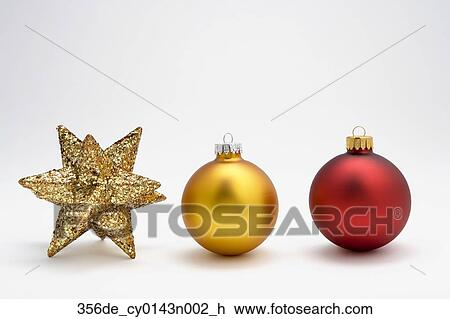 Stock photo of two christmas tree bulb ornaments in row with star