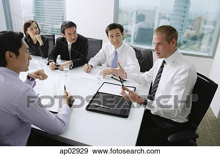 Excellent Executives Having A Discussion Around Conference Table Caucasian Man At The Head Of The Table Stock Photo Beutiful Home Inspiration Ommitmahrainfo