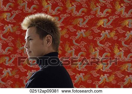 Profile Of Smiling Man Chinese Silk Backdrop Stock Image
