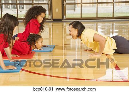 stock photography of african female gym teacher teaching