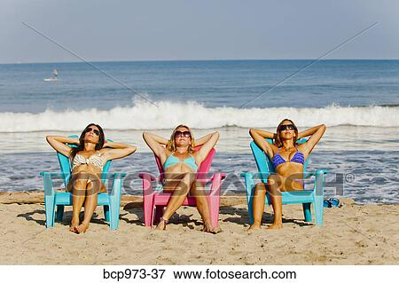 Prime Three Women Lounging On Beach Chairs Stock Photo Bcp973 37 Ocoug Best Dining Table And Chair Ideas Images Ocougorg