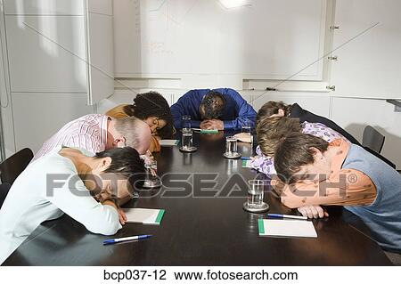 Stock Photo Of Colleagues Asleep At Conference Table Bcp - 12 person conference table