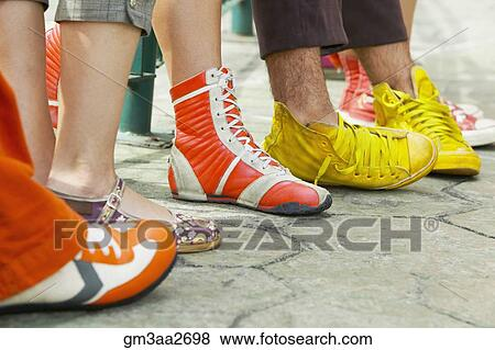 close up of group of young people's feet with funky shoes