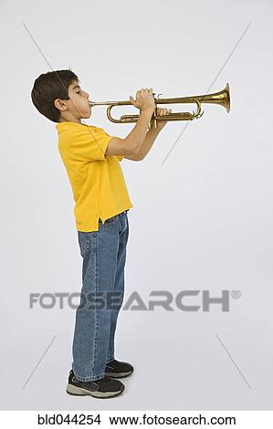 Middle Eastern boy playing trumpet Picture