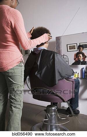 Stock Photography Of African Hair Stylist Cutting Mixed Race Mans