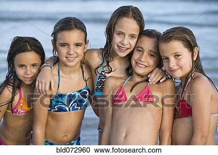 stock photography of hispanic girls in bikinis posing on beach