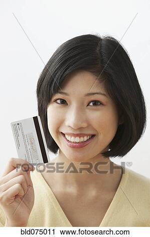 stock photography of filipino woman holding credit card bld075011