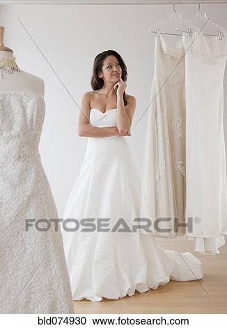 Mixed Race Woman Trying On Wedding Dresses Stock Image