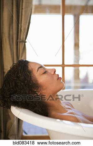Pictures of Mixed race woman soaking in bathtub bld083418 - Search ...