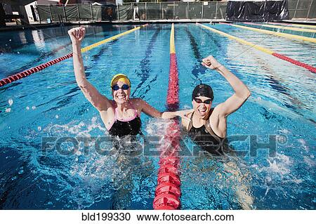 Competitive Swimmers Cheering In Swimming Pool