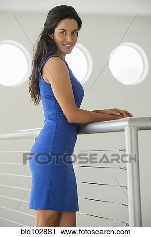 stock photography of hispanic woman leaning on railing bld102881
