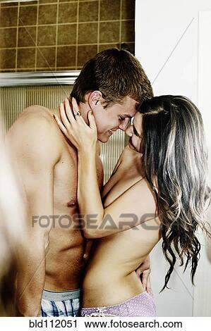 Nude Caucasian Couple Hugging In Bathroom