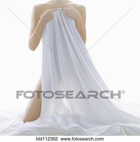 Naked Woman With Lillies Covering Groin Mid Section High