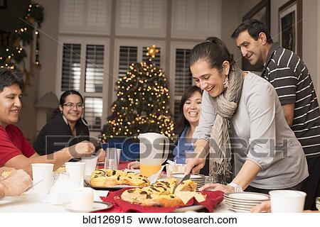 Hispanic Family Enjoying Traditional Christmas Dessert