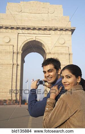 Indian couple photographing India Gate, Delhi, India Picture ...