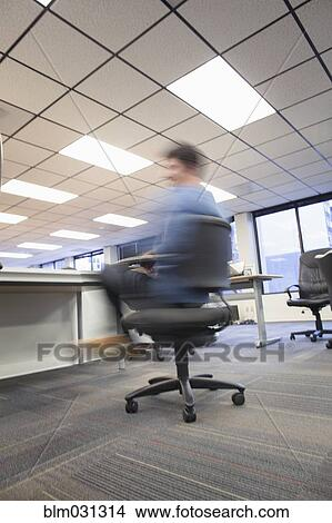 Businessman Spinning In Office Chair