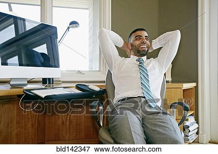 Magnificent Middle Eastern Businessman Relaxing In Chair At Desk In Spiritservingveterans Wood Chair Design Ideas Spiritservingveteransorg