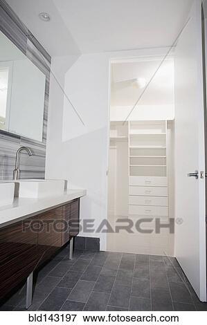 Door Open To Walk In Closet From Modern Bathroom Stock Photo Bld143197 Fotosearch