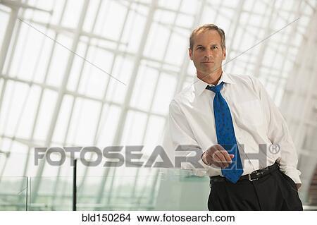 stock photo of caucasian businessman leaning on railing bld150264