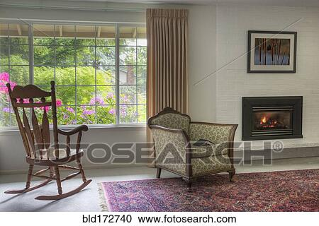 Chairs and fireplace in traditional living room Stock Image ...