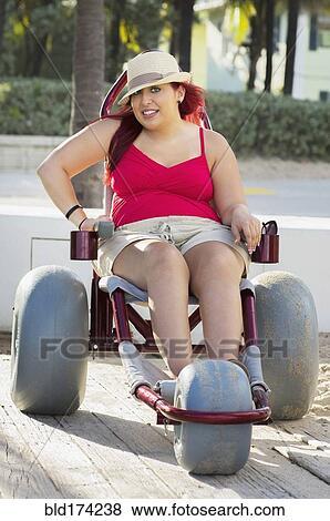 6d053a8729971 Paraplegic woman in wheelchair on walkway Stock Photo   bld174238 ...