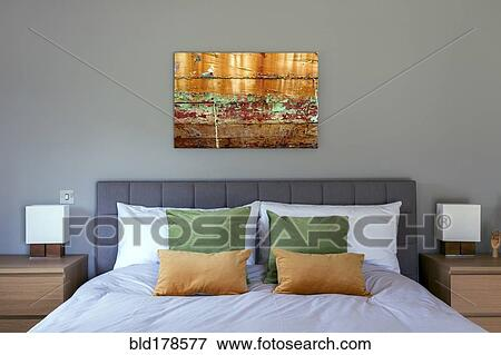 Bed and wall art in modern bedroom Stock Photo | bld178577 ...