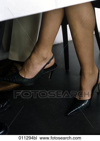 Stock Photo of female legs under the table in a restaurant 011294bl