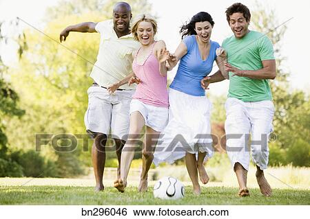 Friends playing soccer Stock Photograph | bn296046 ...