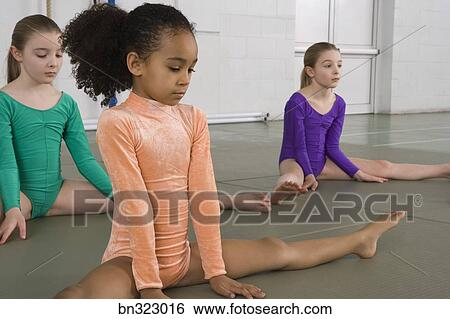 Girls stretching in gymnastics practice Stock Photograph | bn323016 |  Fotosearch