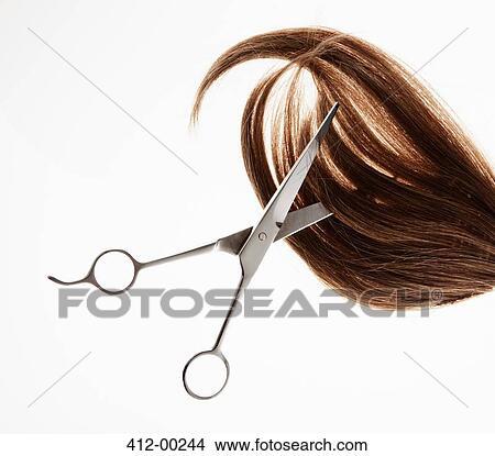 Stock Photo of Scissors cutting through brunette hair 412-00244 ...