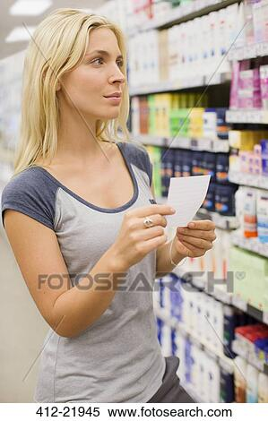 stock image woman reading shopping list in grocery store fotosearch search stock photos